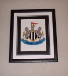 Framed NUFC crest cross-stitch