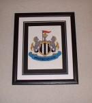 Framed NUFC crest cross-stitch